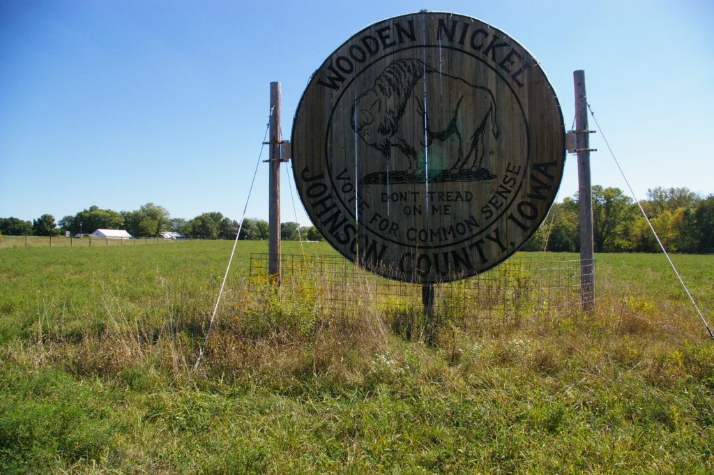 World's Largest Wooden Nickel in a field in Iowa City, Iowa