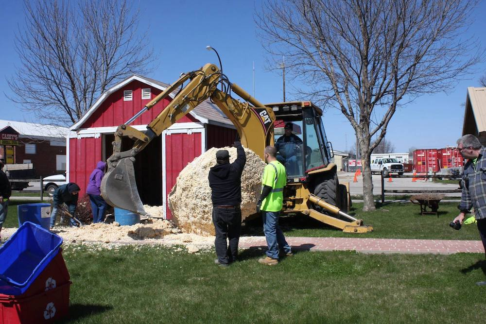 Removing previous World's Largest Ball of Popcorn with bulldozer in Sac City, Iowa
