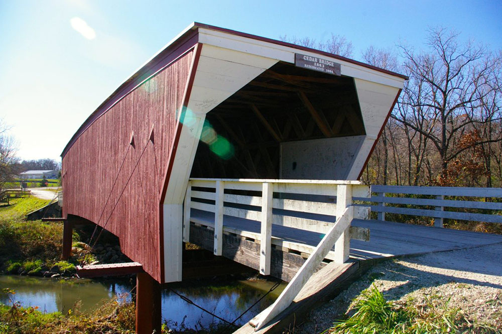 Red and white painted exterior of the Cedar Covered Bridge, one of the six remaining Bridges of Madison County near Winterset, Iowa