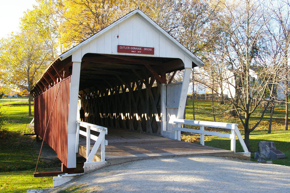 Red and white painted exterior of the Cutler-Donahoe Covered Bridge located in Winterset City Park, one of the six remaining Bridges of Madison County near Winterset, Iowa