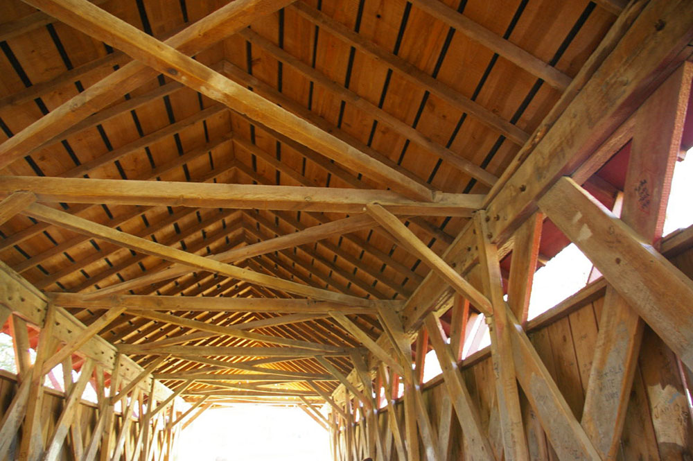 Intricate wood beams inside the Cutler-Donahoe Covered Bridge in Winterset City Park in Winterset, Iowa
