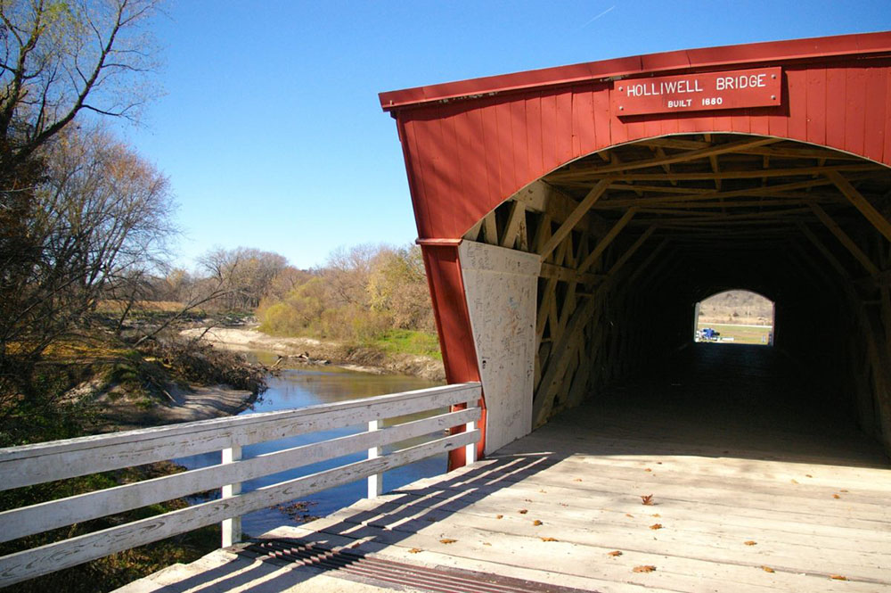 Red painted exterior and entrance of the Holliwell Covered Bridge, , one of the six remaining Bridges of Madison County near Winterset, Iowa
