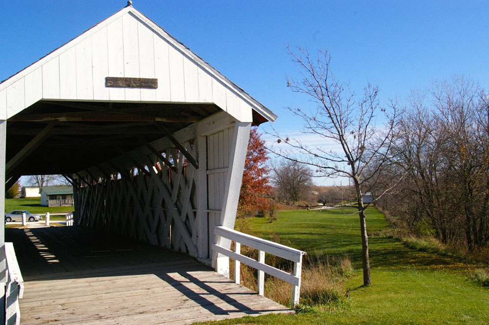 White painted exterior of Imes Covered Bridge, one of the six remaining Bridges of Madison County near Winterset, Iowa