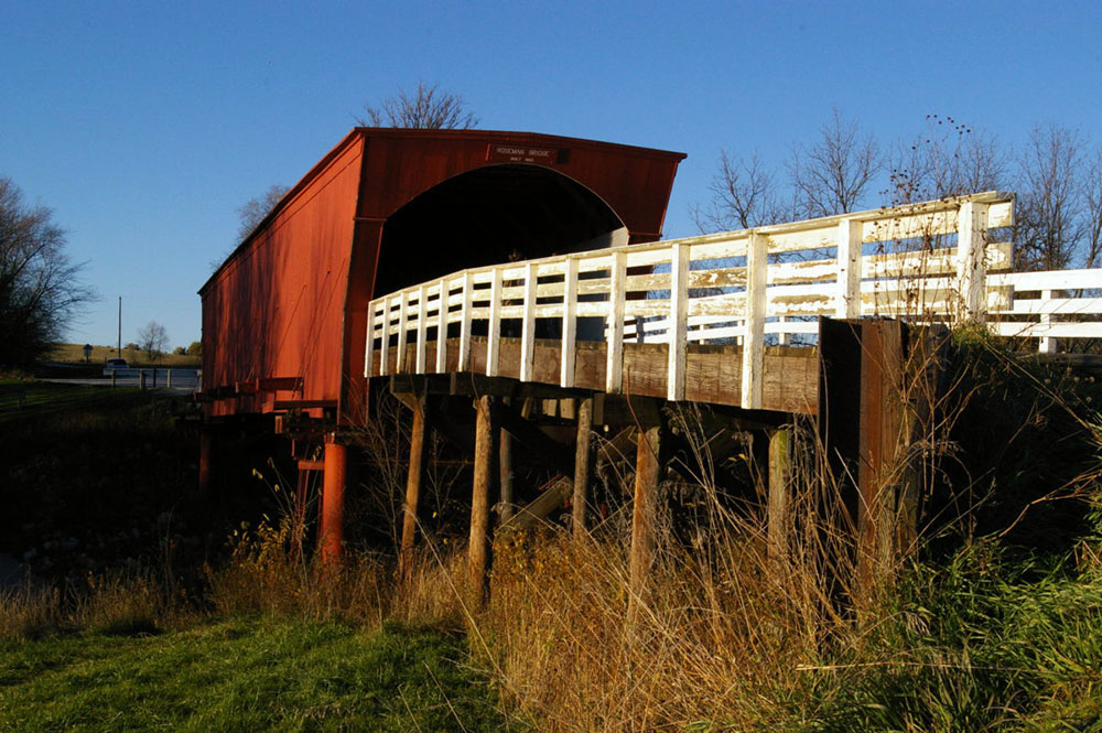 Red and white painted exterior of Roseman Covered Bridge, one of the six remaining Bridges of Madison County near Winterset, Iowa