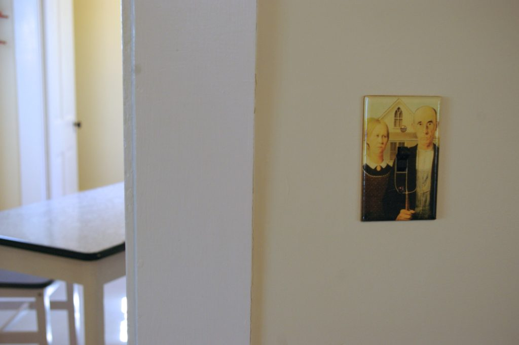 American Gothic light switch plate inside the American Gothic House in Eldon, Iowa