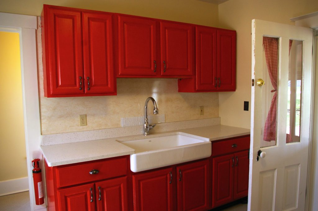 Red kitchen cabinets inside the American Gothic House in Eldon, Iowa