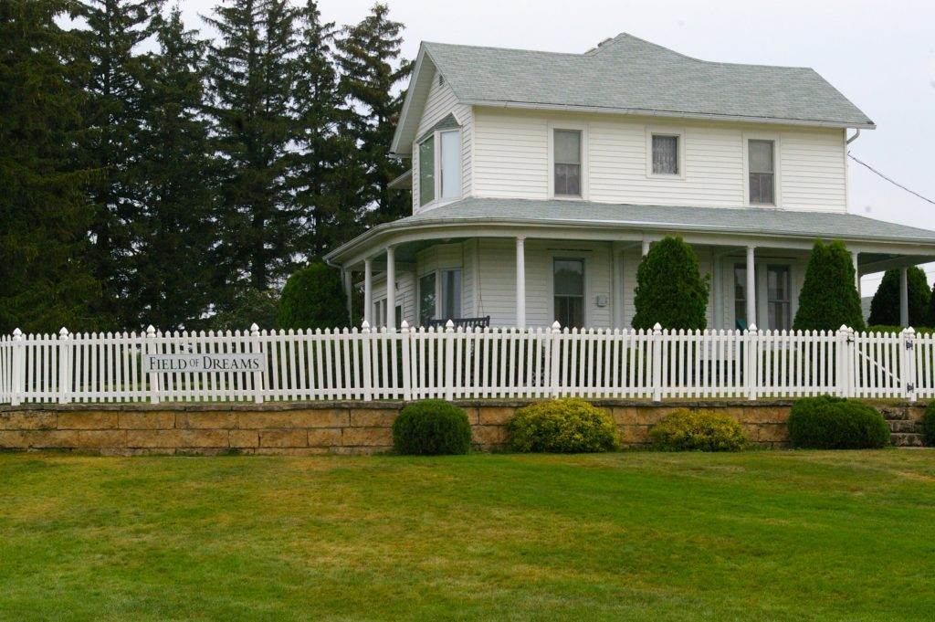 White farmhouse with picket fence at the Field of Dreams in Dyersville, Iowa