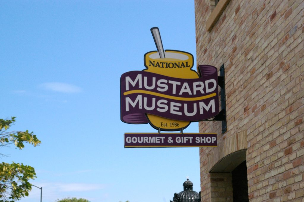 Mustard jar shaped sign that reads National Mustard Museum Gourmet & Gift Shop at the National Mustard Museum near Madison, Wisconsin