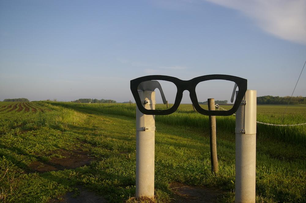 Buddy Holly glasses in a field near Clear Lake, Iowa