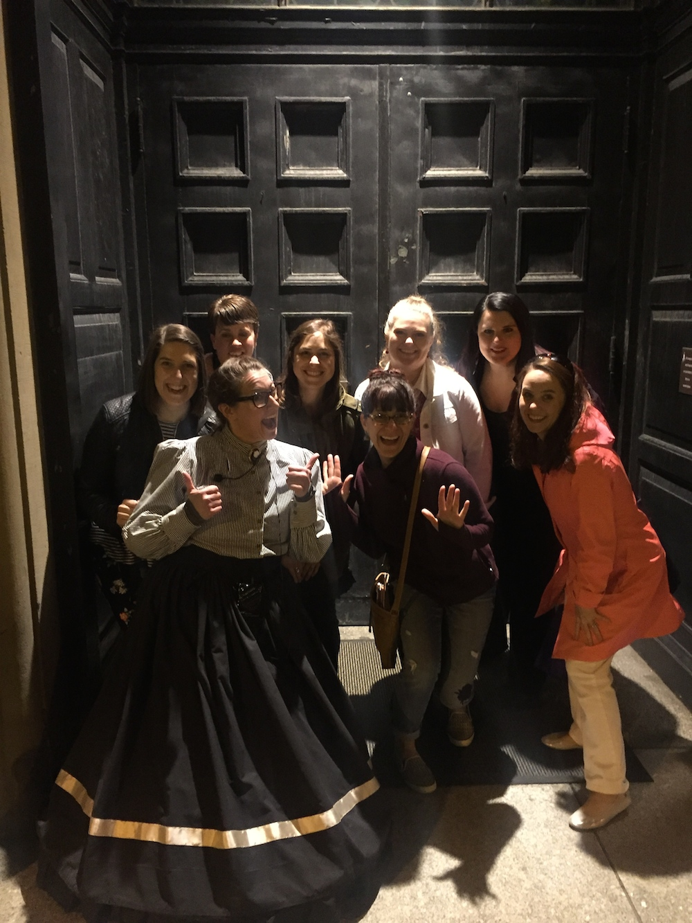 Travel bloggers pose with Anna of Gothic Milwaukee tours after a ghost tour of downtown Milwaukee, Wisconsin