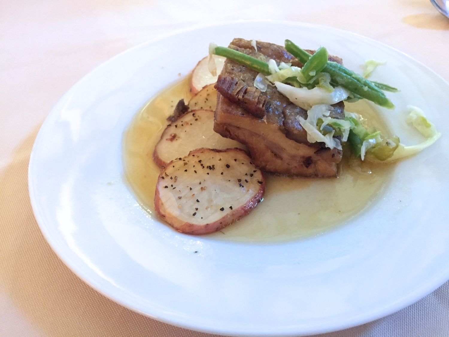 Braised pork shoulder at Harvestville Farm's farm-to-table dinner series in Donnellson, Iowa