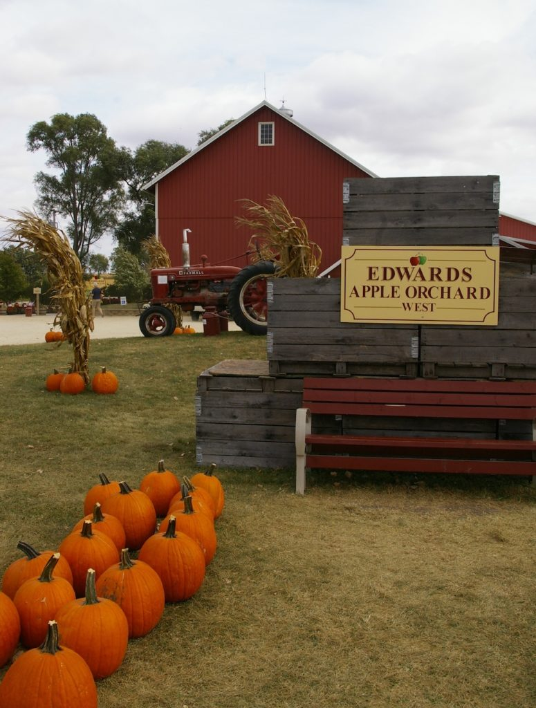 Exterior of red barn and tractor at Edwards Apple Orchard West near Rockford, Illinois