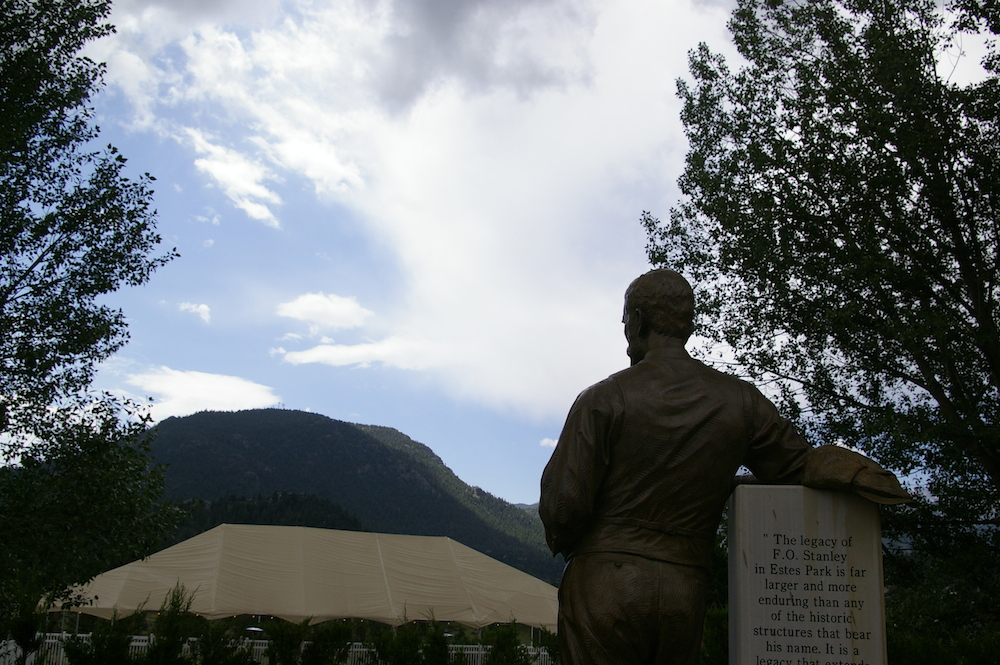Statue of F.O. Stanley overlooking the Rocky Mountains outside of the Stanley Hotel in Estes Park, Colorado