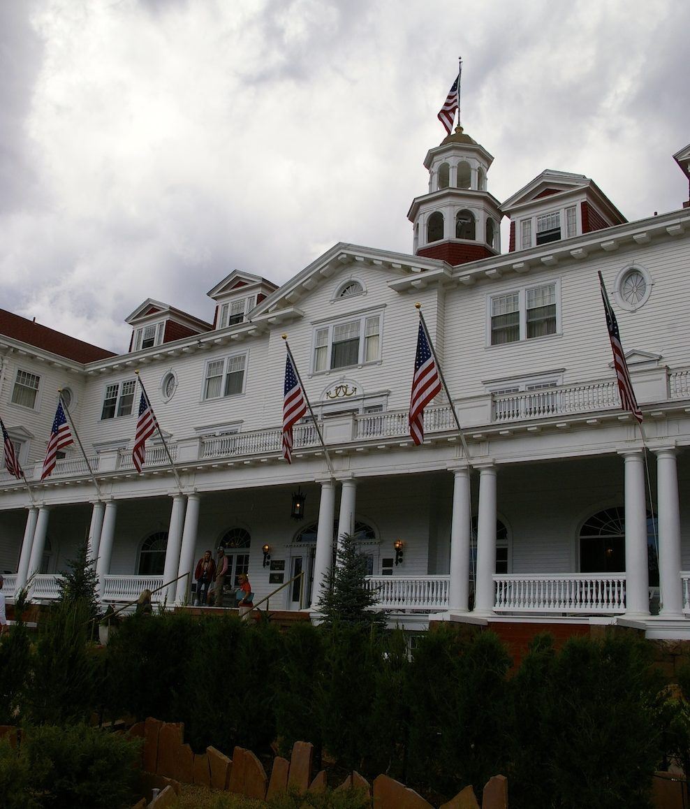 White exterior of the Stanley Hotel in Estes Park, Colorado