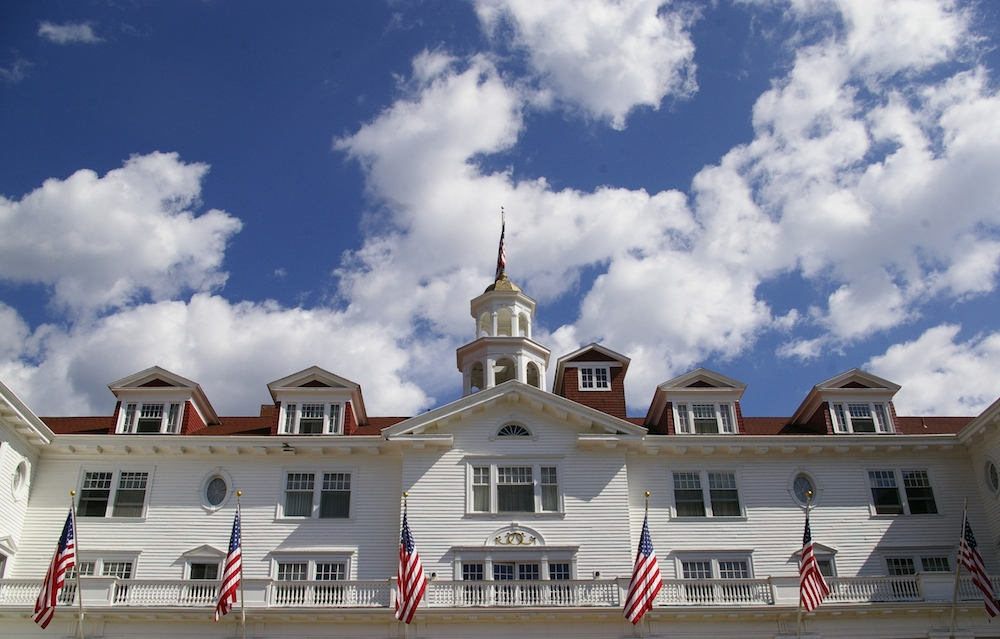 Exterior of the Stanley Hotel with blue sky near Estes Park, Colorado