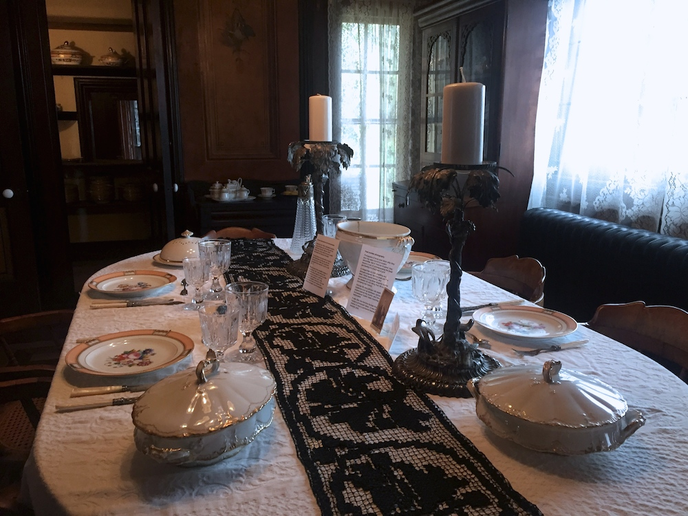 Historic table setting in the dining room of the historic Tinker Swiss Cottage in Rockford, Illinois