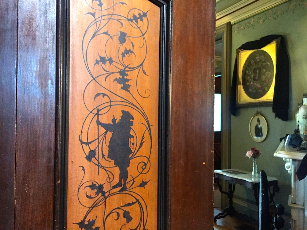 Intricate wood detailing on the interior of the historic Tinker Swiss Cottage in Rockford, Illinois