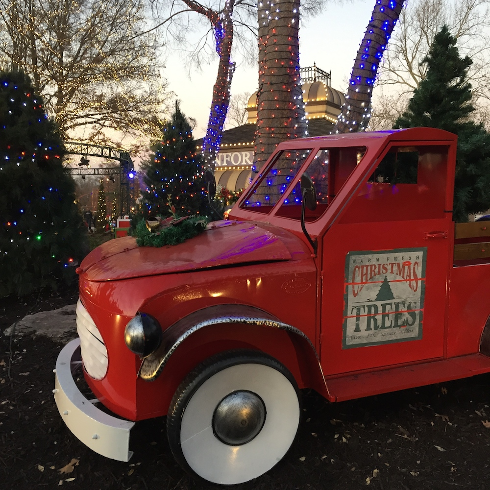 Red miniature pickup truck with Christmas decorations at Worlds of Fun's WinterFest in Kansas City, Missouri