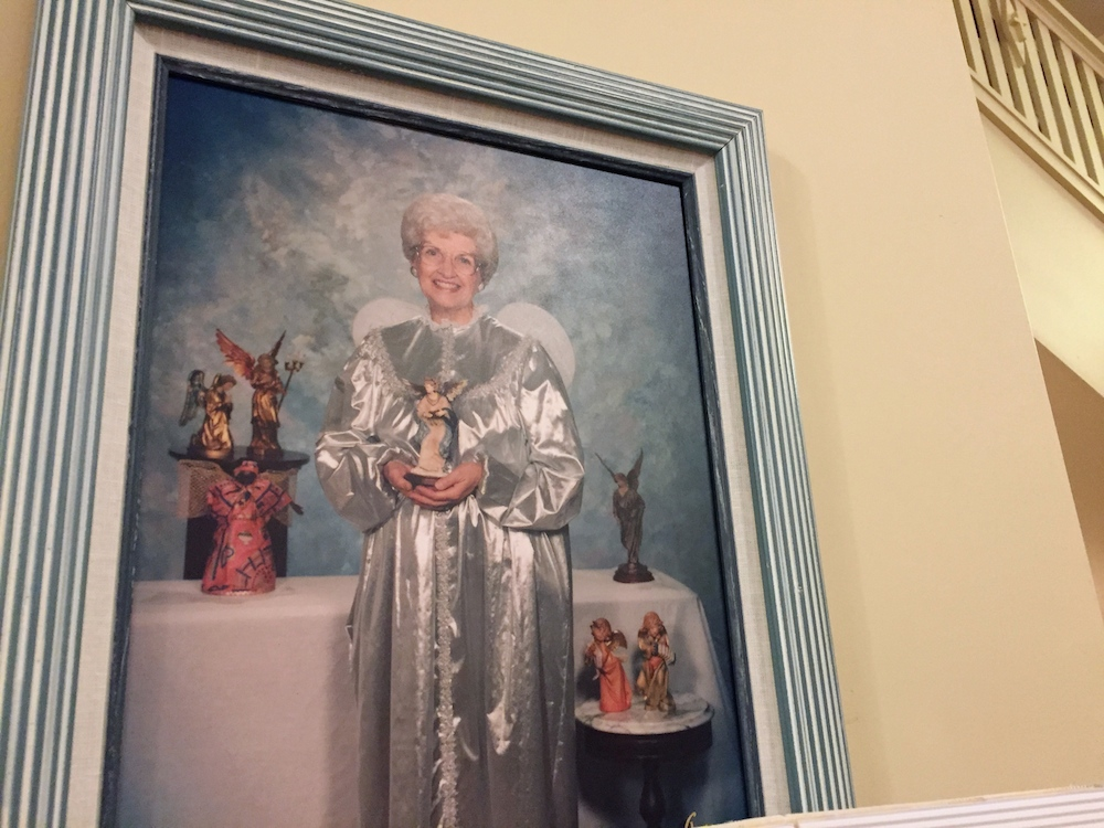 Portrait of founder Joyce Berg dressed as an angel at the Angel Museum in Beloit, Wisconsin