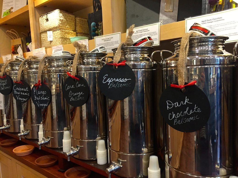 Silver canisters of flavored balsamic vinaigrettes at The Bodacious Shops at Block 42 in Janesville, Wisconsin