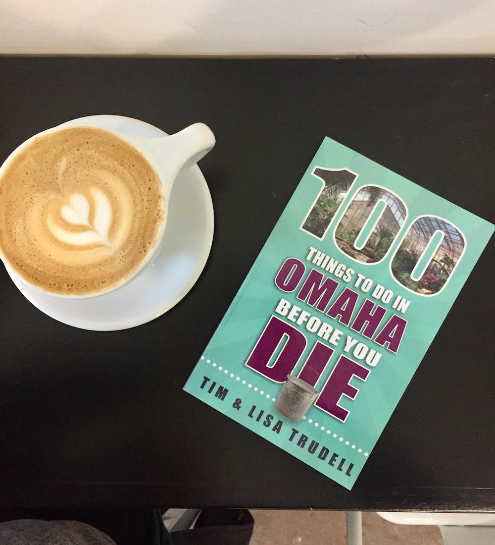 100 Things to Do in Omaha Before You Die book with latte on counter
