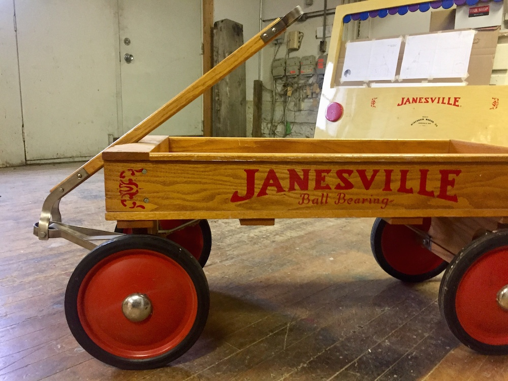 Small wagon with red wheels from the Wisconsin Wagon Company in Janesville, Wisconsin
