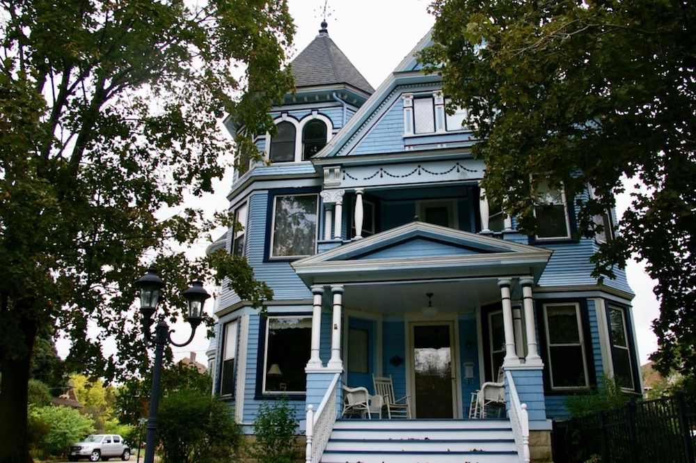 Blue victorian home in the Courthouse Hill Historic District of Janesville, Wisconsin