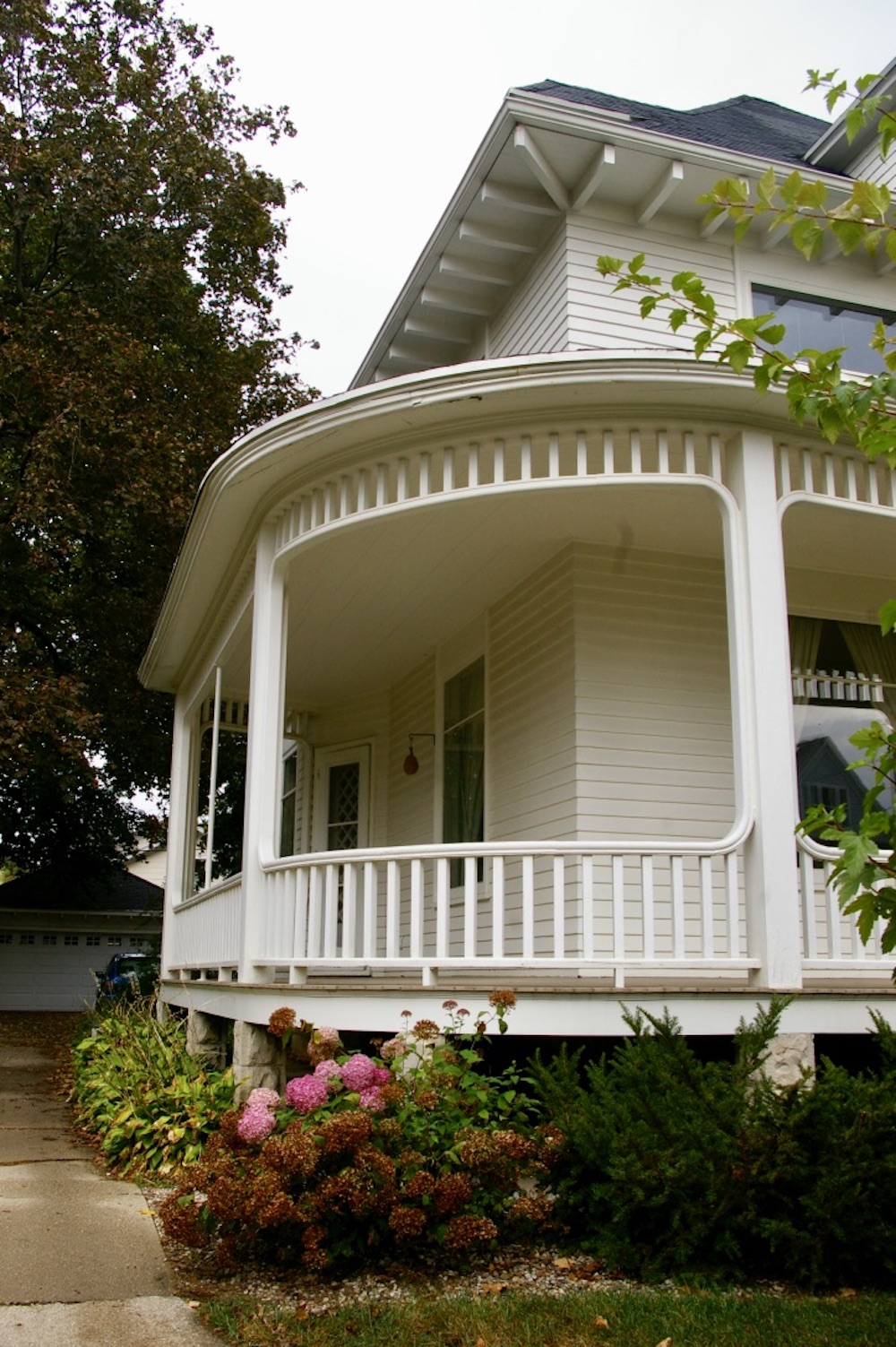 Wraparound porch of a home in the Courthouse Hill Historic District of Janesville, Wisconsin