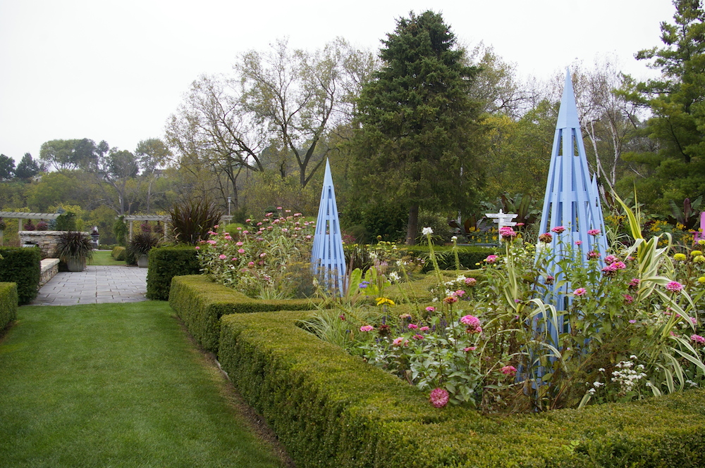 Hedges with flowers and blue trellis at the Rotary Botanical Gardens in Janesville, Wisconsin