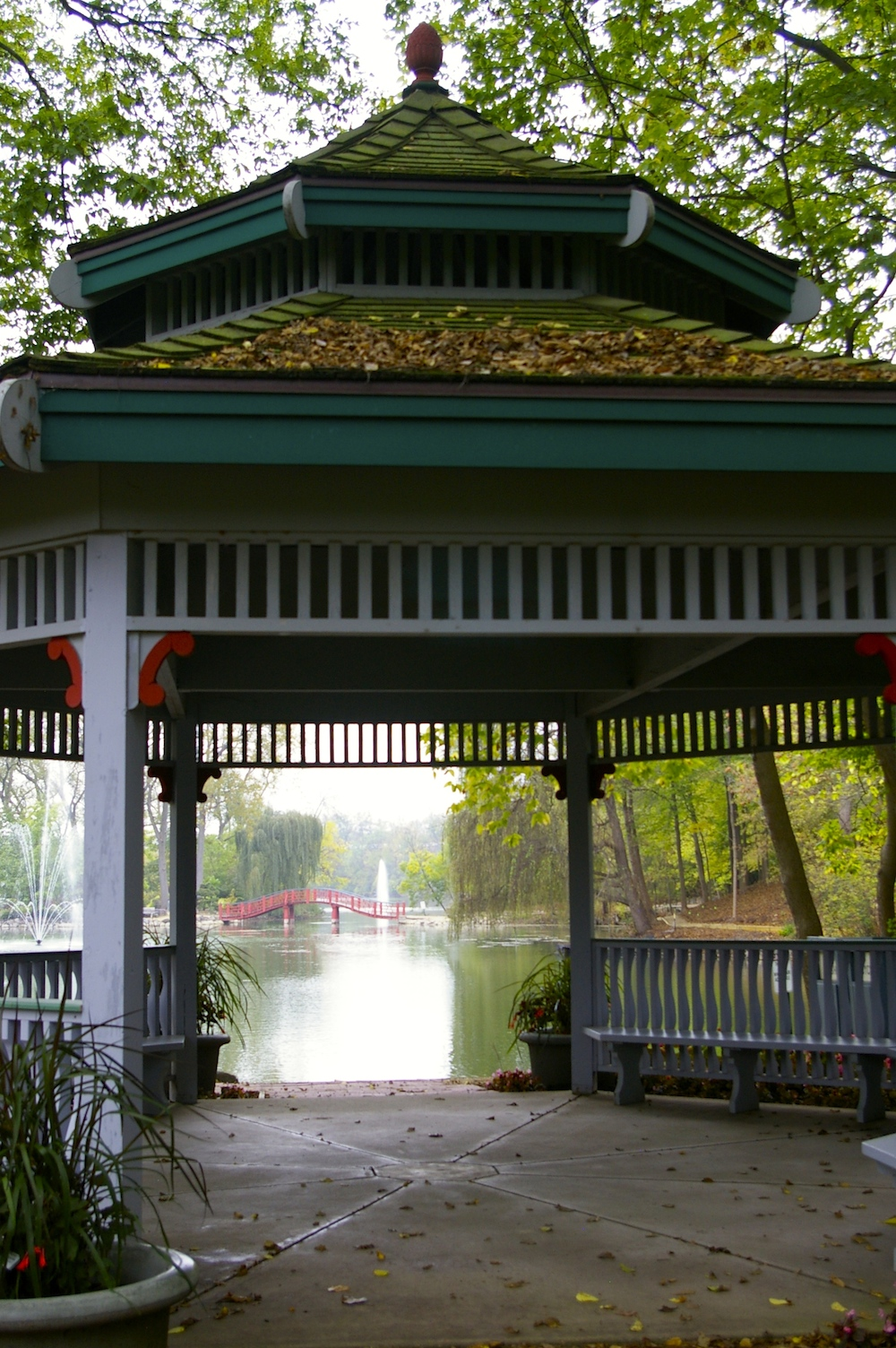 Gazebo with view of red bridge and fountain in the background at the Rotary Botanical Gardens in Janesville, Wisconsin