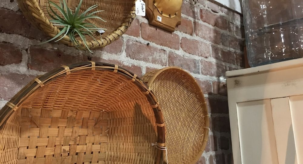 Wicker baskets and plants on the wall of Rescued Junk in Earlham, Iowa