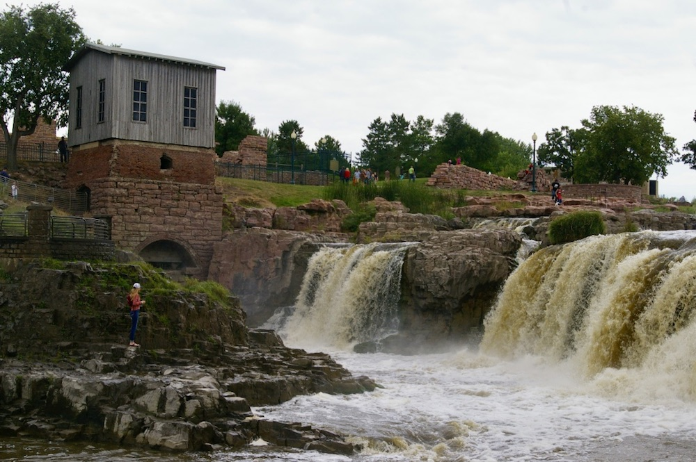 Historic buildings overlooking the falls at Falls Park in Sioux Falls, South Dakota