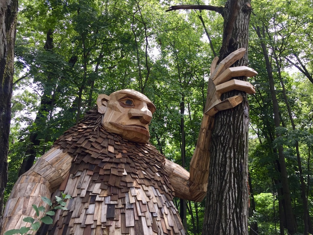 Large troll sculpture in the trees at the Morton Arboretum Troll Hunt in Lisle, Illinois