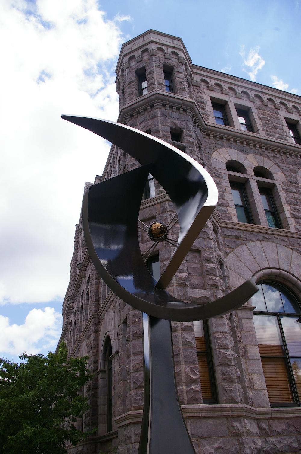 Metal spiral sculpture along the SculptureWalk in downtown Sioux Falls, South Dakota