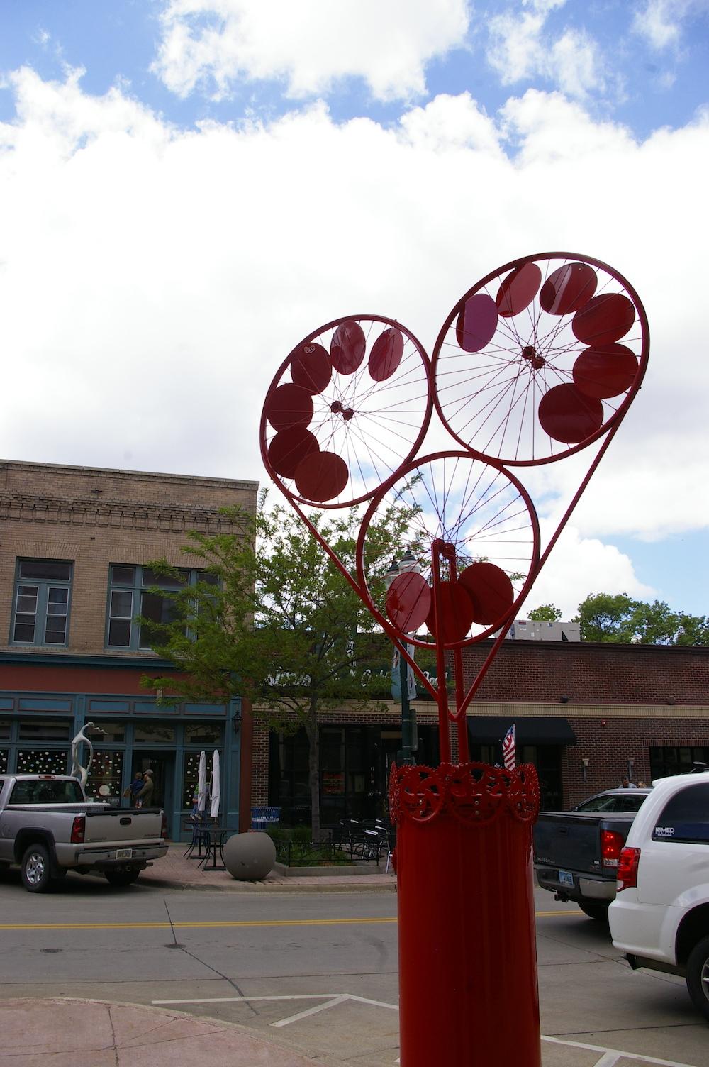 Heart sculpture made of bike parts along the SculptureWalk in downtown Sioux Falls, South Dakota
