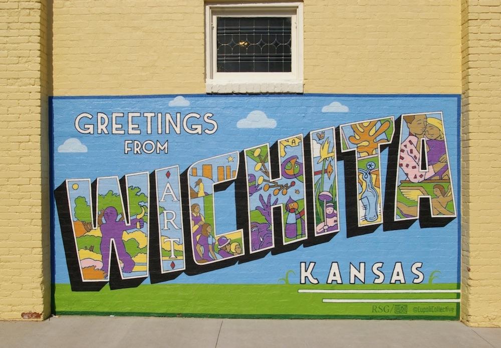 Greetings from Wichita, Kansas mural featuring iconic sites of Wichita in the Douglas Design District in downtown Wichita, Kansas