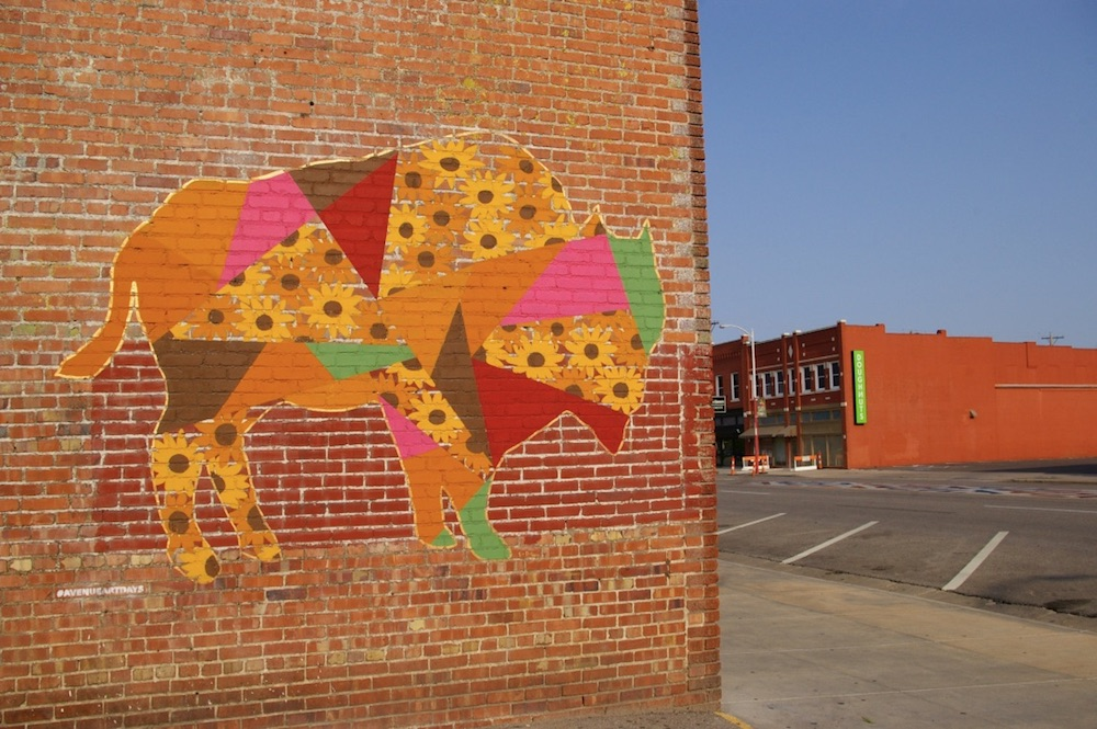 Mural of a bison made up of sunflowers in the Douglas Design District of Wichita, Kansas