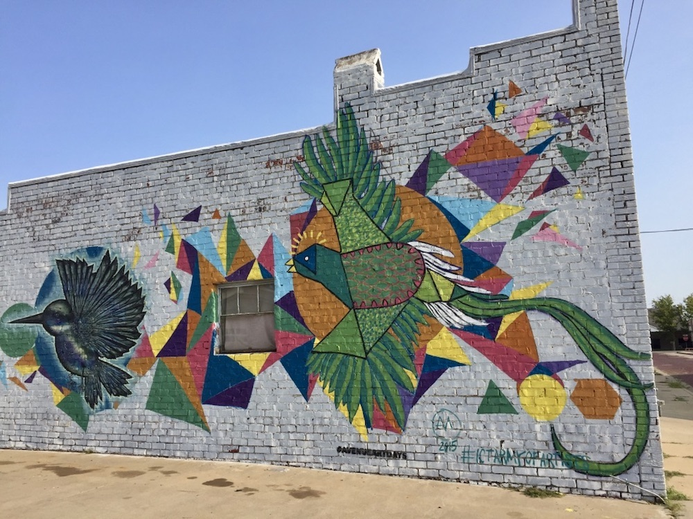 Colorful geometric mural with birds in the Douglas Design District in downtown Wichita, Kansas