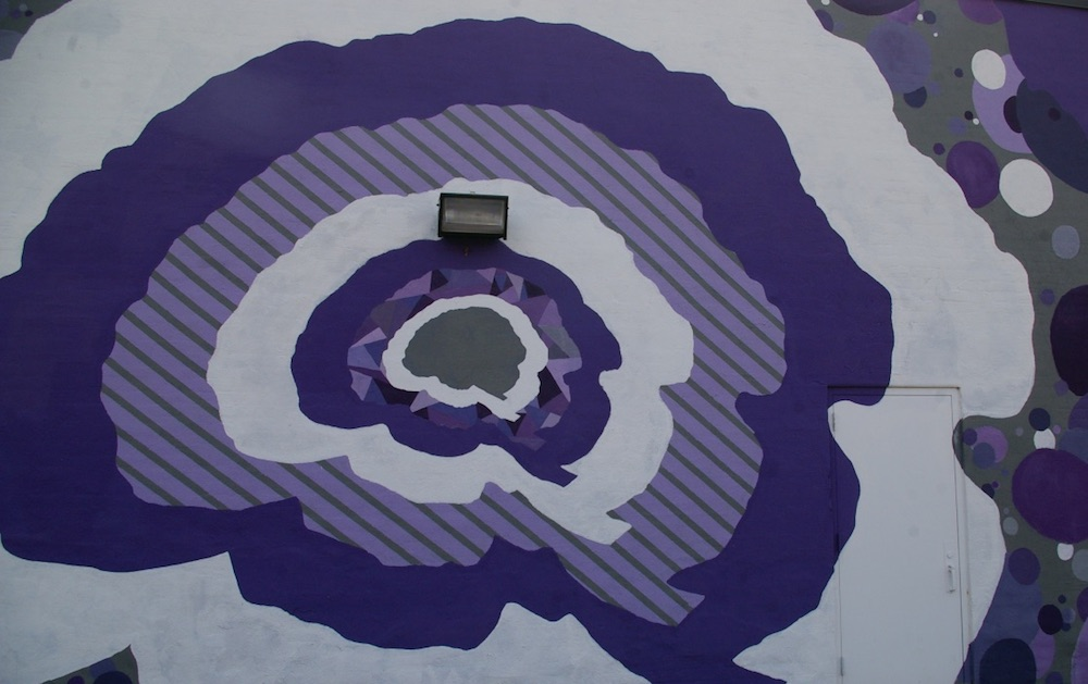 Purple brain shapes mural in the Douglas Design District of Wichita, Kansas