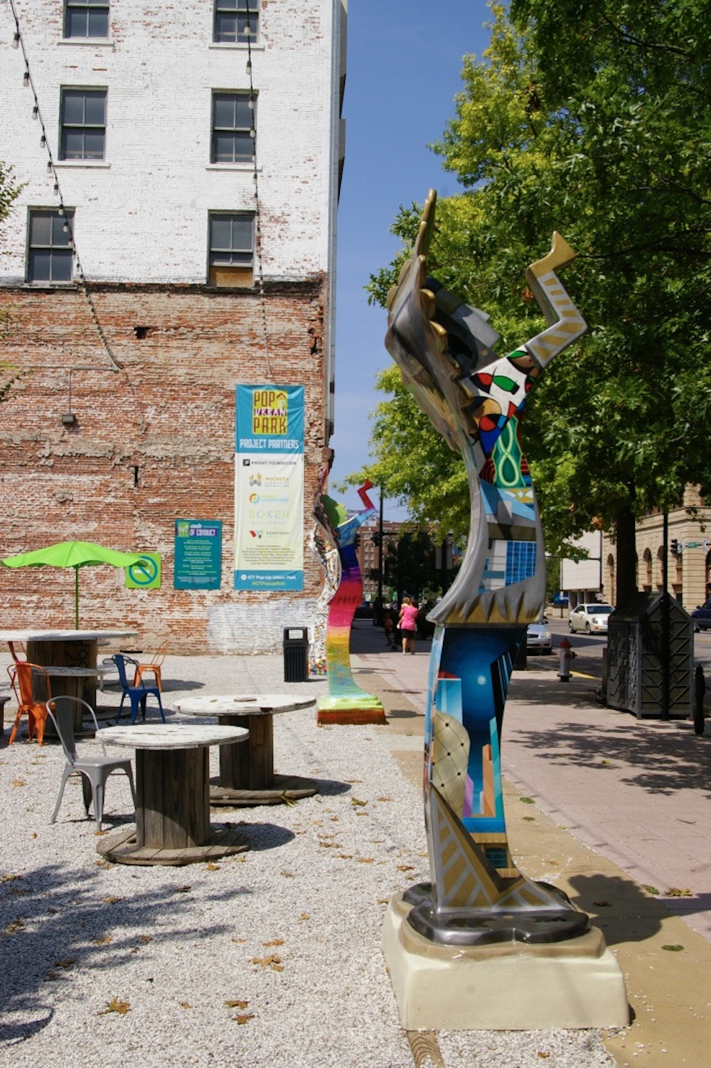 Decorated Keeper of the Plains statue at the ICT Pop-Up Urban Park in downtown Wichita, Kansas