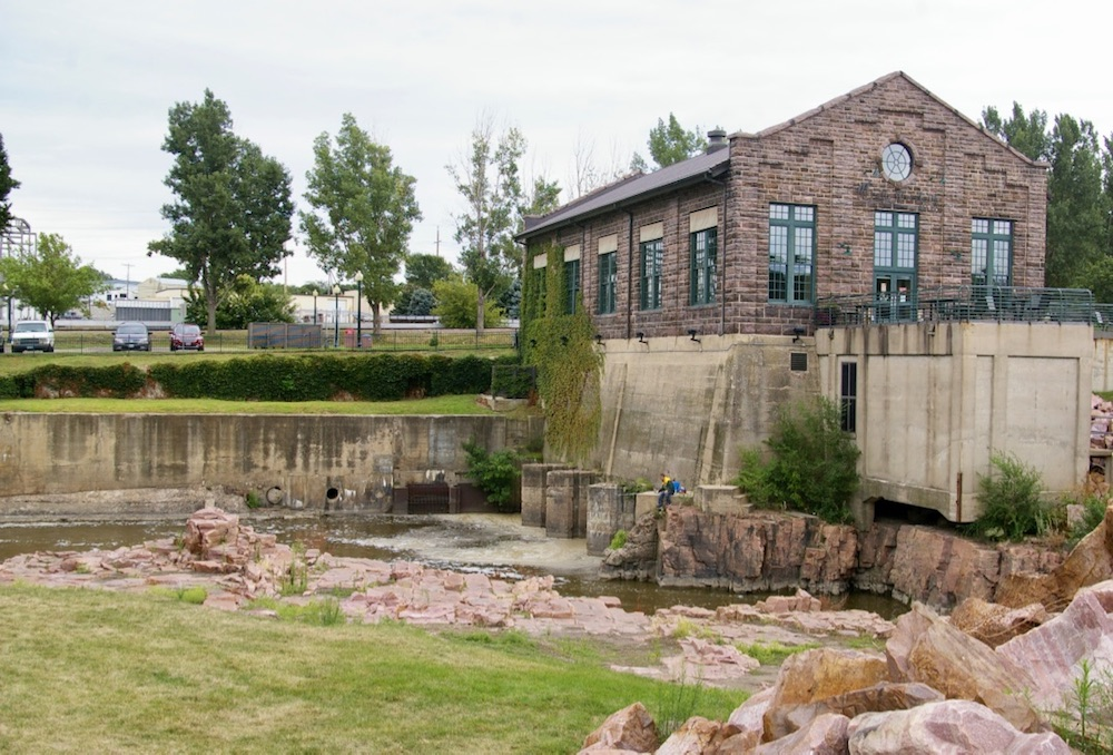 Exterior of Sioux Falls Light and Power Plant building that houses the Falls Overlook Cafe in Falls Park in Sioux Falls, South Dakota