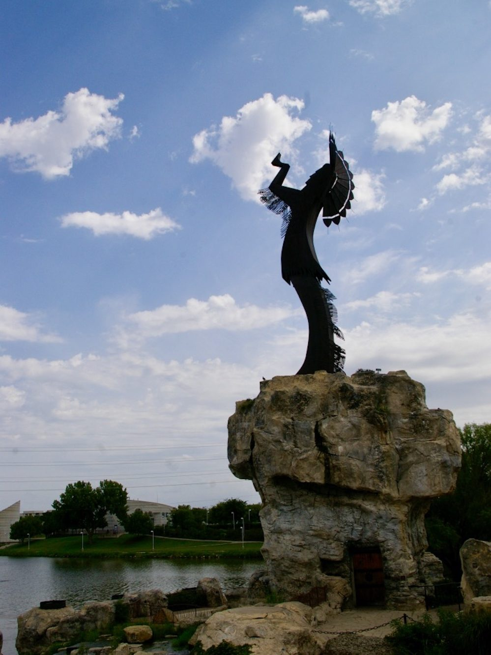 Large metal sculpture of a Native American warrior known as the Keeper of the Plains at the confluence of the Arkansas and Little Arkansas rivers in Wichita, Kansas