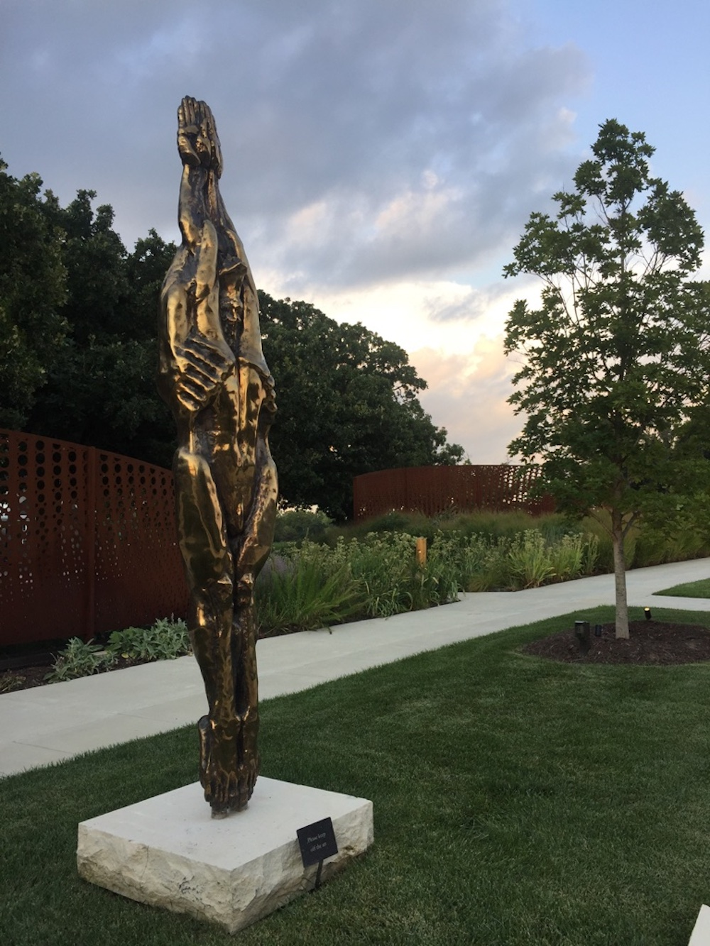 Metallic sculpture of an elongated torso outside of the Wichita Art Museum in Wichita, Kansas
