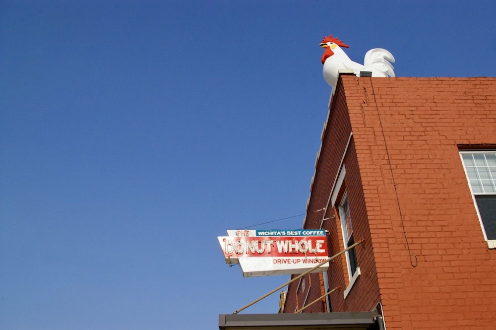 Rooster statue on top of a building at The Donut Whole in Wichita, Kansas