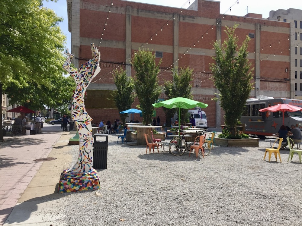 Food trucks and colorful patio seating at the ICT Pop-Up Park in downtown Wichita, Kansas