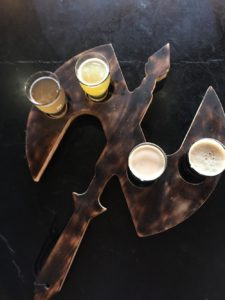Flight of beers in a battle axe shaped folder at Nortons Brewing Company in Wichita, Kansas