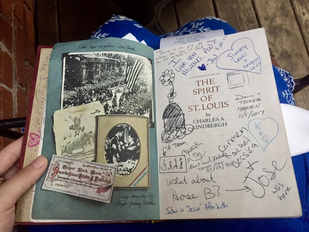 Old book full of messages and signatures with check at Public at the Brickyard in Wichita, Kansas