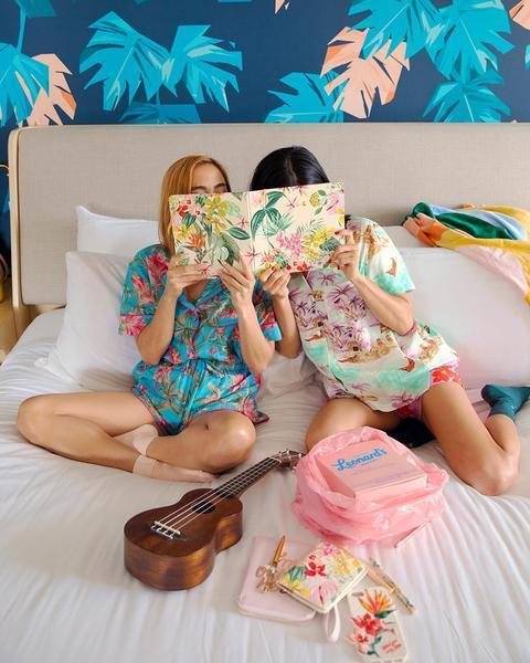 Two girls reading ban.do travel planner