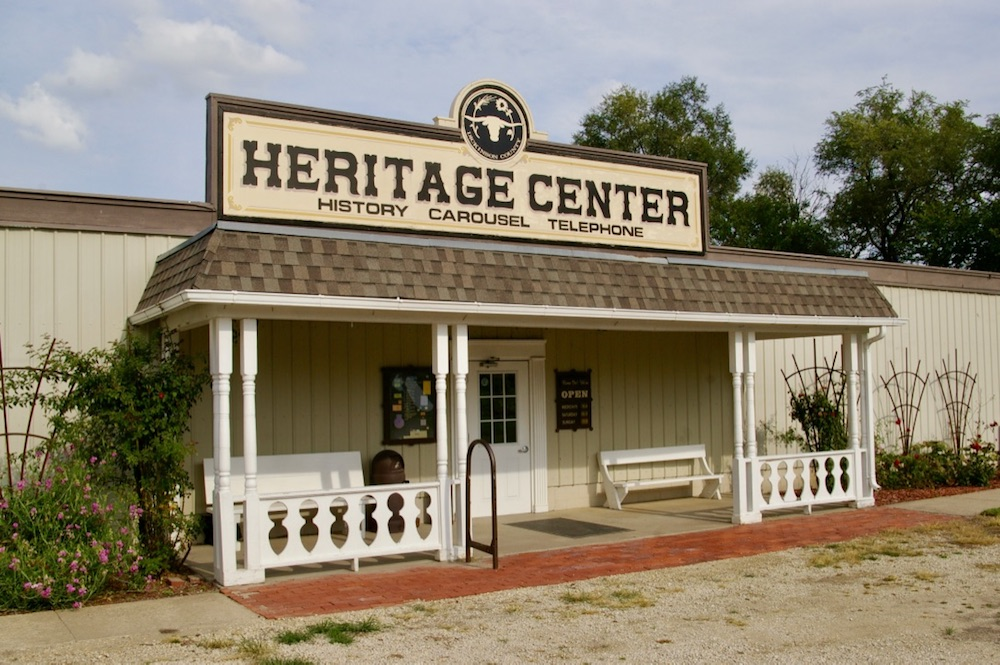 Small building with exterior porch and sign that reads Heritage Center at the Dickinson County Heritage Center in Abilene, Kansas