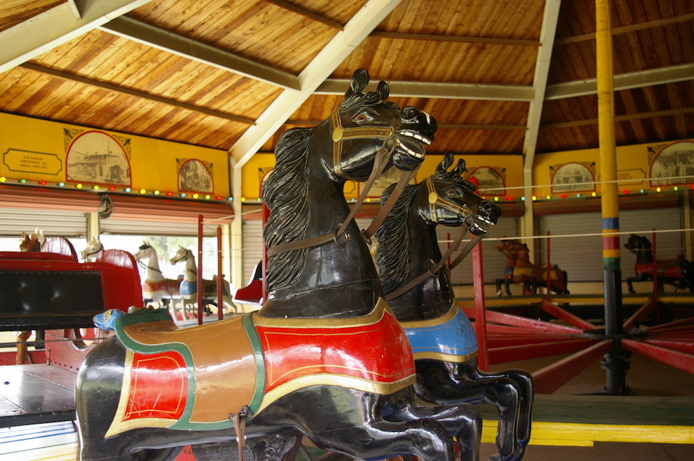 Black carousel horse with red and gold saddle at the Dickinson County Heritage Center in Abilene, Kansas